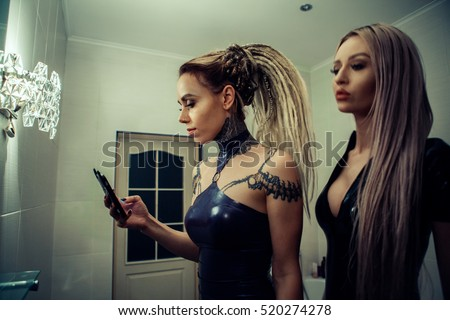 two girls in latex