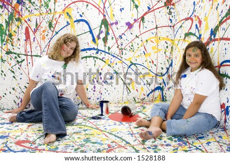 Two beautiful sisters covered in paint.