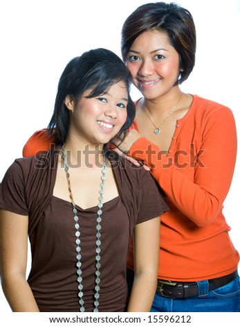 Two beautiful sisters from Asian background. - stock photo
