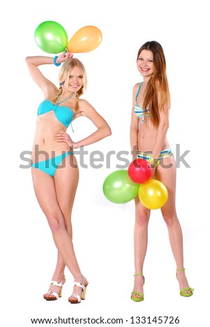 Two beautiful smiling girl in bikini with baloons - stock photo