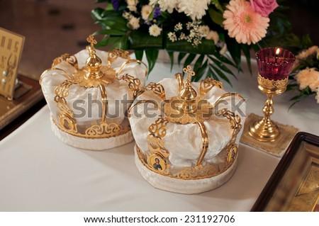 Two beautiful wedding crowns in church - stock photo