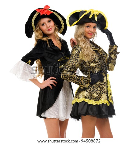 Two beautiful women in carnival costumes. Pirate and empress shape. Isolated image - stock photo