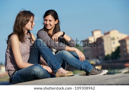 Two Beautiful Women in the City, Italy Pisa - stock photo