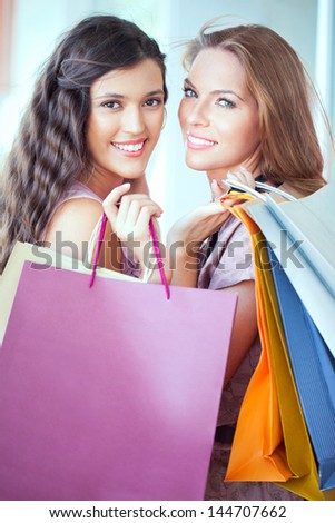 Two beautiful women shopping together.