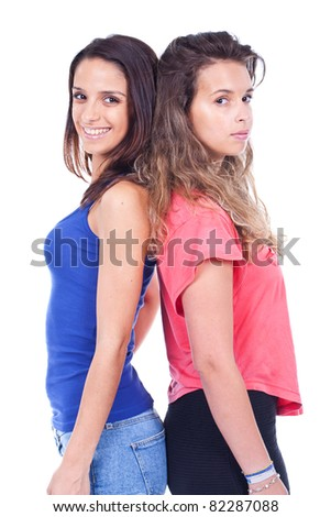 two beautiful women standing and posing - stock photo