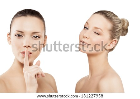 two beautiful women with a finger on lips showing to keep silence, hush
