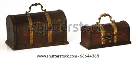 Two beautiful wooden chest with golden stripes. - stock photo
