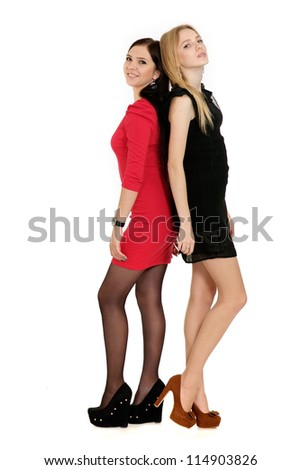 Two beautiful young girls posing on white - stock photo