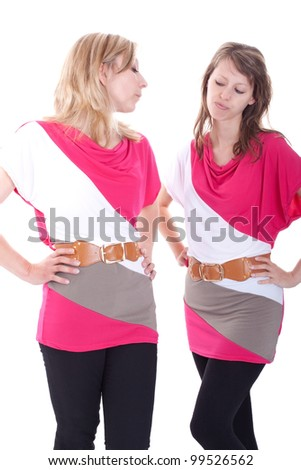 two beautiful young woman compete for a dress - stock photo