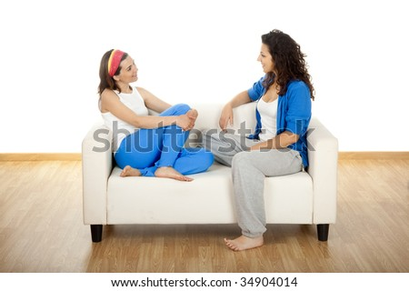 Two beautiful young women's sitting on a sofa