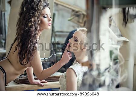 Two beauty women - be quiet - stock photo