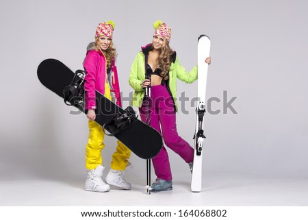 Two beauty women with winter equipment - stock photo