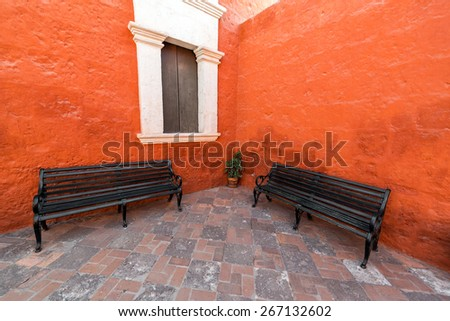 Two benches in the colorful Santa Catalina monastery in Arequipa, Peru - stock photo