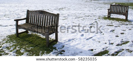 Two benches on the lawn in Downing College Cambridge University - stock photo