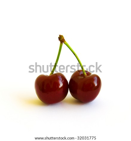 two berries of ripe cherry on a white background