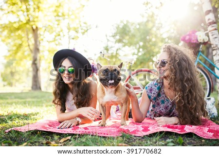 Two best friends and cute dog. Selective focus, depth of field   - stock photo