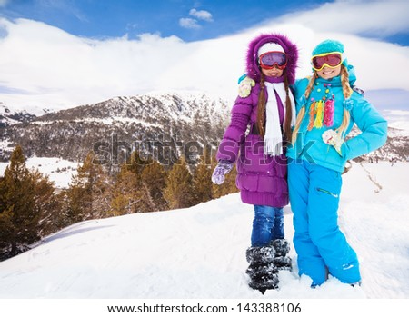 Two best friends girls spending vacation on the ski resort in mountains - stock photo