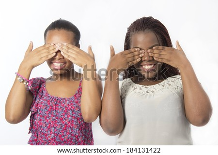 Two best friends Hand gesture see no evil - stock photo
