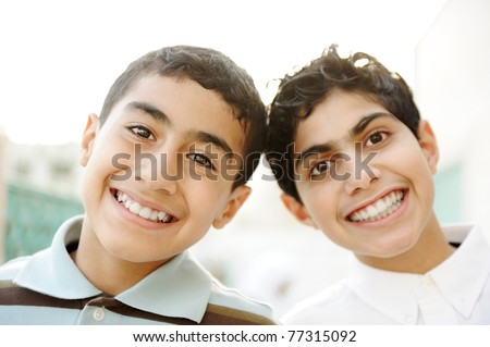 Two best friends with white healthy teeth laughing widely outdoor