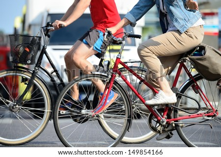 Two bicycles in traffic - stock photo