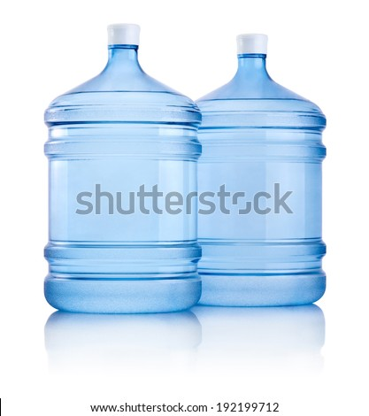 Two big bottles of water isolated on white background - stock photo