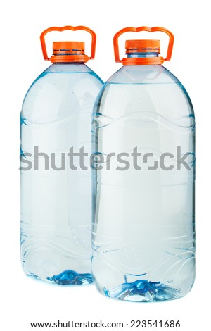 Two big full plastic water bottles with orange caps isolated on white background - stock photo