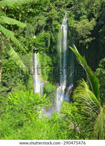 Two big waterfalls with rainbow, Bali, Indonesia - stock photo