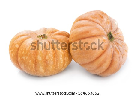 Two big yellow ripe pumpkin close-up on white background. - stock photo