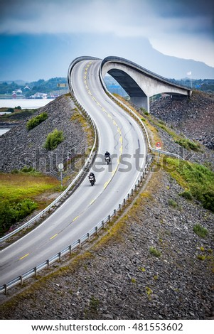 "Two bikers on motorcycles. Atlantic Ocean Road or the Atlantic Road (Atlanterhavsveien) been awarded the title as ""Norwegian Construction of the Century""."