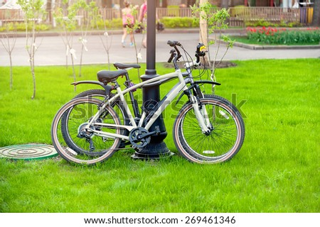 two bikes in spring park  - stock photo