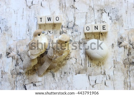 Two birds one stone concept photo with dice and objects over head view - stock photo
