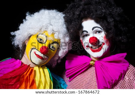Two birthday clown's in the black background - stock photo