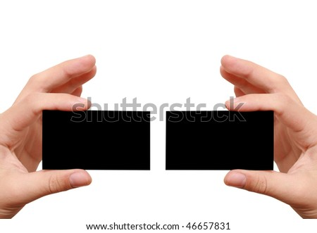 two black business cards in hands - stock photo