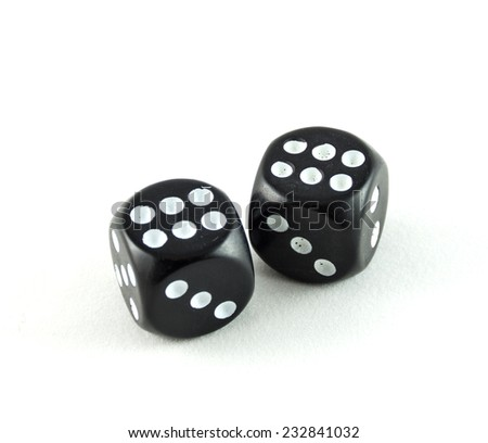 Two black casino cubes isolated on white background. - stock photo