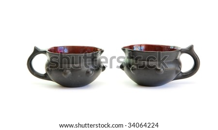 Two black decorative ceramic pots isolated