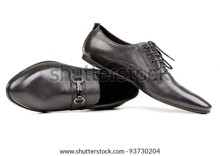 Two black men shoes against white background - stock photo