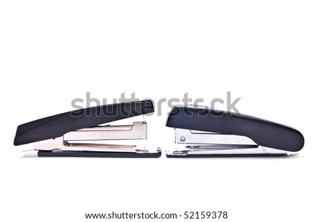 Two black staplers isolated on white background