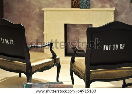 Two black vintage luxury  armchairs  in front of fireplace(chimney) - stock photo