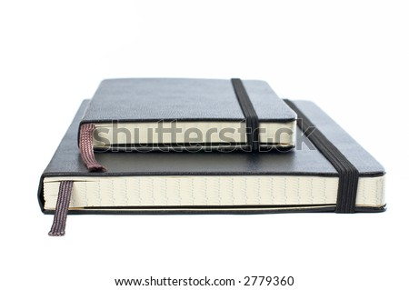 Two blacks notebooks with soft shadow on white background - stock photo