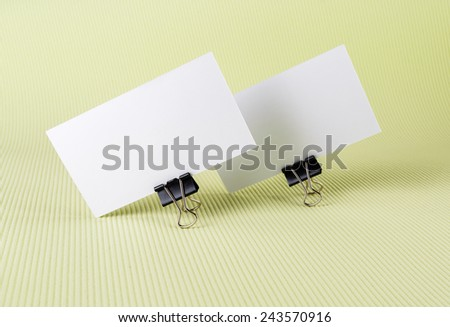 Two blank business card with soft shadows on green background. - stock photo