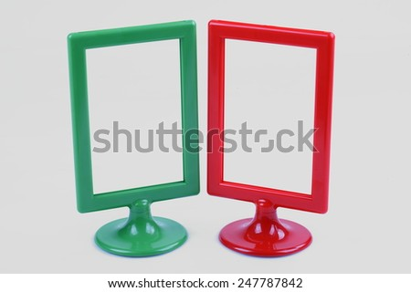 Two blank contemporary desktop picture frame isolated on white - stock photo