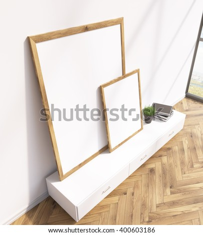 Two blank frames on white floor shelf, white wall, window to the right. Side view. Concept of painting. Mock up. 3D rendering