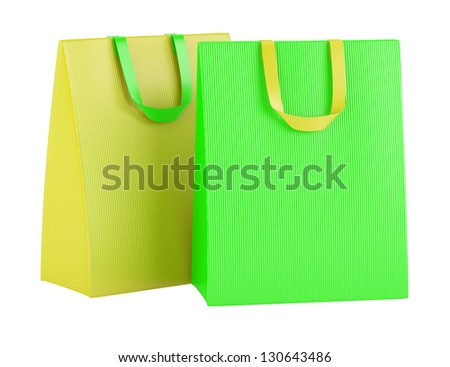 two blank green and yellow shopping bags isolated on white background - stock photo
