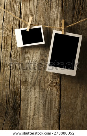 Two Blank photographs hanging on a clothesline - stock photo