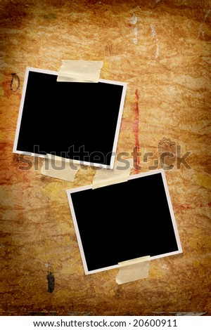 Two blank photographs on a grungy wooden background - stock photo