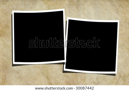 Two blank photographs on a vintage background. - stock photo