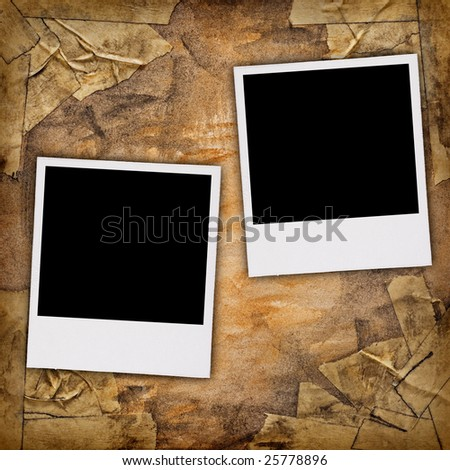 Two blank photos on a grungy background