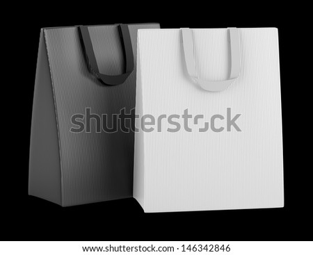 two blank shopping bags isolated on black background - stock photo