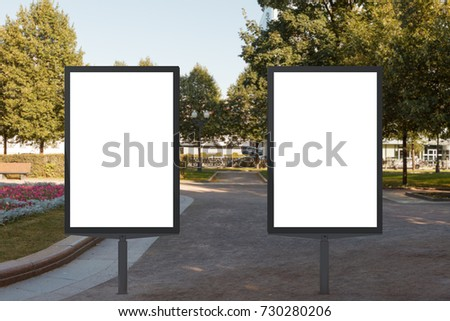 Two blank street billboard posters in urban park. 3d illustration.