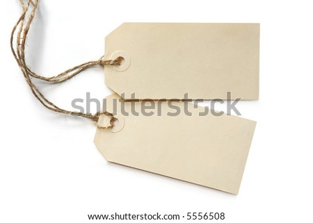 Two blank tags, tied with string, reflected on white surface. - stock photo